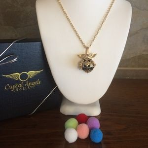 Gold angel wing essential oil necklace